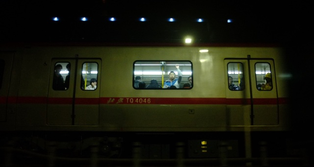 Man on train in Beijing